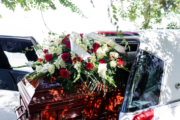 a casket in the back of a hearse
